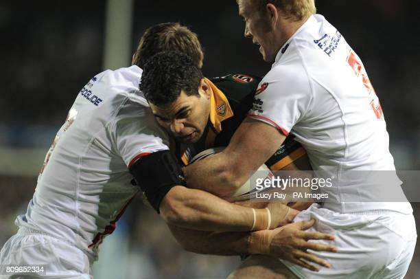 Australia's Greg Inglis is tackled by England's Kevin Sinfield and Jack Reed during the Four Nations Final match at Elland Road Leeds