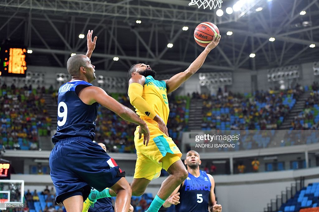 http://media.gettyimages.com/photos/australias-guard-patty-mills-goes-to-the-basket-despite-frances-point-picture-id586425976