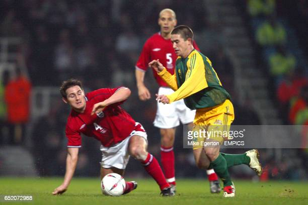 Australia's Harry Kewell wins the ball as England's Frank Lampard gets to his feet