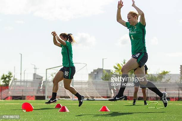 Australia's Hayley Raso and Clare Polkinghorne run through some drills during their practice session in Edmonton Canada on June 23 2015 as the team...