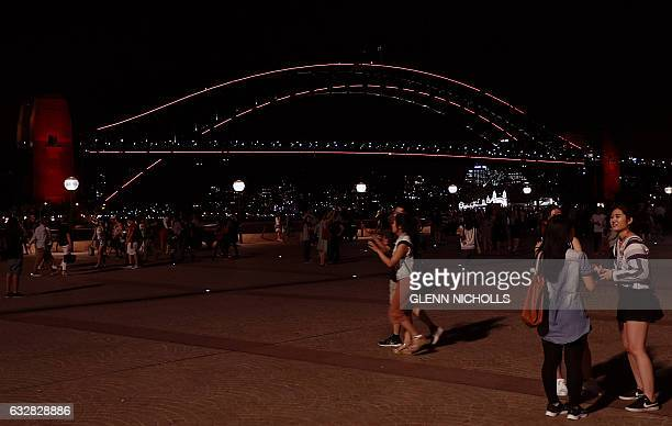 Australia's iconic Harbour Bridge is lit up in red in connection with the Chinese Lunar New Year celebrations in Sydney on January 27 2017 Much of...