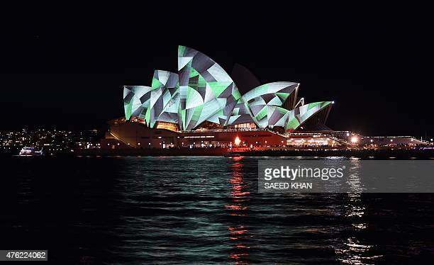 Australia's iconic Opera House is lit up during a light show called 'Vivid Sydney' on June 7 2015 Vivid Sydney an annual festival of light music and...