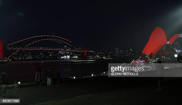 Australia's iconic Opera House is lit up in red in connection with the Chinese Lunar New Year celebrations in Sydney on January 27 2017 Much of the...