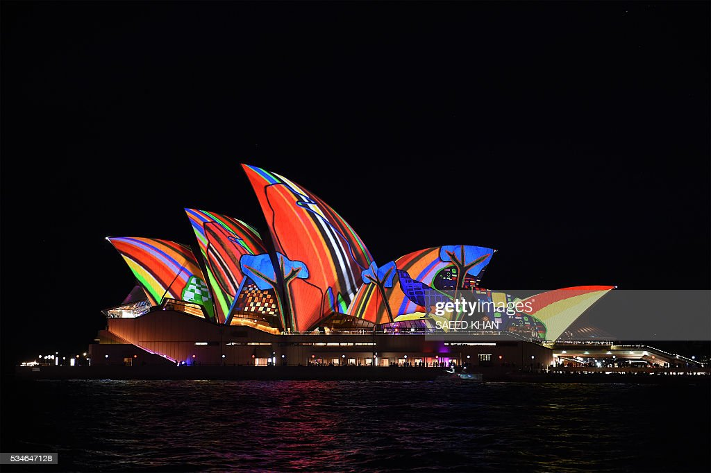 Australia's iconic Opera House is lit up with an art installation called 'Songlines' on the opening night of Vivid Sydney on May 27, 2016. Vivid Sydney, an annual festival of light, music and ideas, runs from May 27 to June 18. / AFP / SAEED