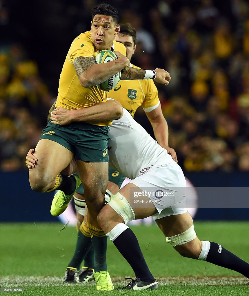 Australia's Israel Folau (L) is tackled by England's George Kruis (R) during their third and final rugby union Test match in Sydney on June 25, 2016. / AFP / SAEED