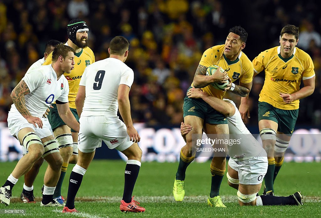 Australia's Israel Folau (3rd R) is tackled by England's George Kruis (2nd R) during their third and final rugby union Test match in Sydney on June 25, 2016. / AFP / SAEED