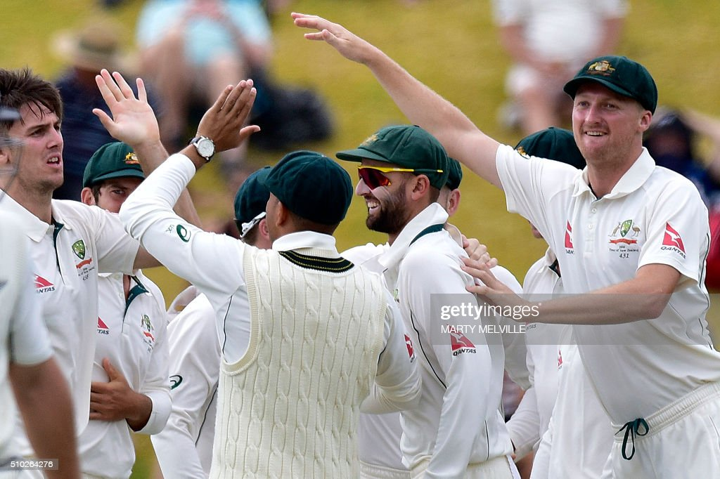 Australia's Jackson Bird (R, Nathan Lyon (C and Mitchell Marsh (L) celebrate New Zealand's Corey Anderson being caught with LBW during day four of the first cricket Test match between New Zealand and Australia at the Basin Reserve in Wellington on February 15, 2016. / AFP / Marty Melville