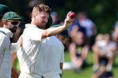 Australia's Jackson Bird shows the ball as they walk off of the field at the end on New Zealand's 2nd innings during day four of the second cricket...