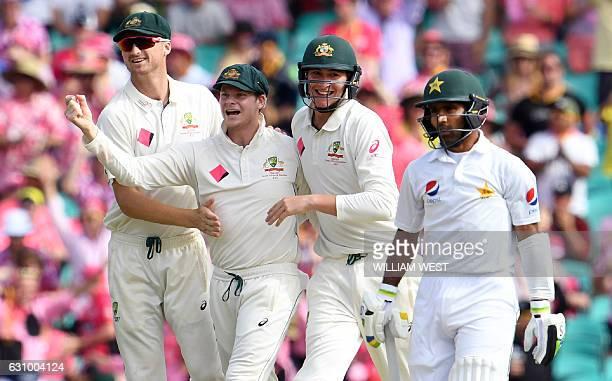 Australia's Jackson Bird Steve Smith and Matt Renshaw celebrate the dismissal of Pakistan batsman Asad Shafiq during the third day of the third...