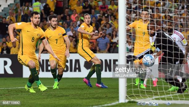 Australia's Jackson Irvine and teammates watches the ball cross the line as he scores against the United Arab Emirates in their World Cup qualifying...