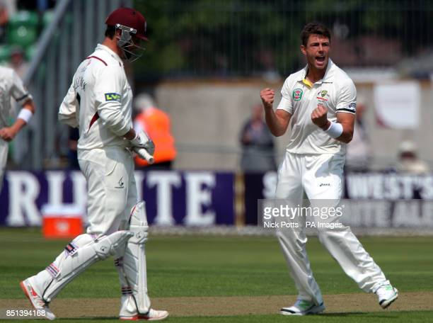 Australia's James Pattinson celebrates taking the wicket of Somerset's Marcus Trescothick during the International Tour match at the County Ground...