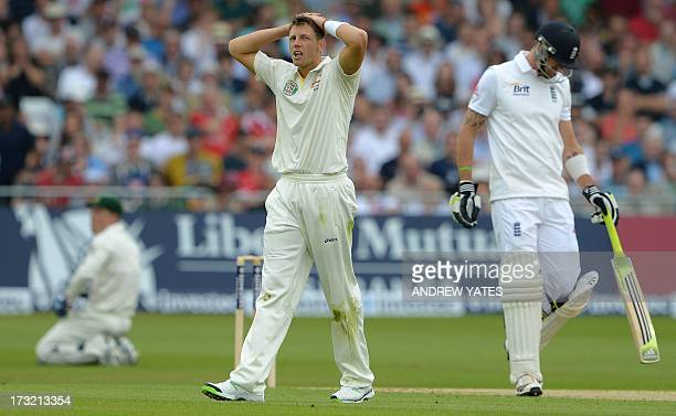 Australia's James Pattinson reacts after bowling to England's Kevin Pietersen during the first days play of the first cricket Test match of the 2013...