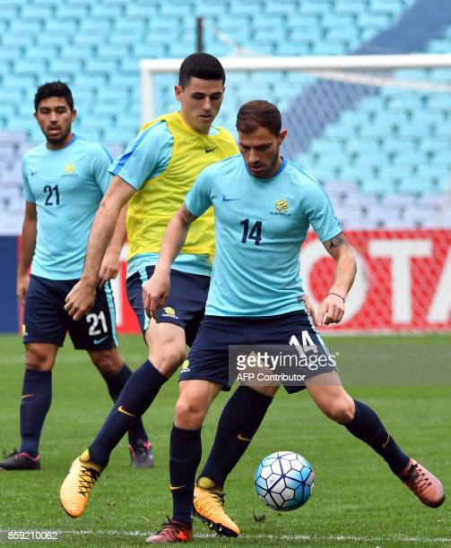 Australia's James Troisi and Tomas Rogic attend a training session in Sydney on October 9 on the eve of their 2018 World Cup football qualifying...