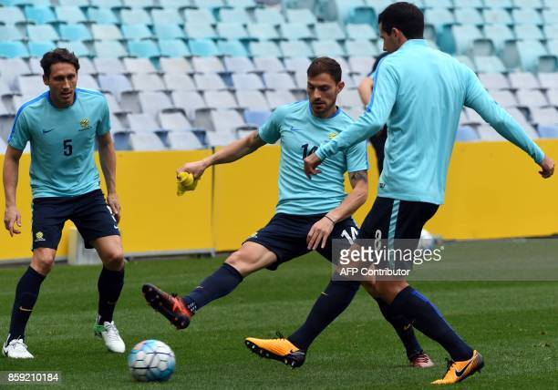 Australia's James Troisi passes the ball to his teammates during a training session in Sydney on October 9 on the eve of their 2018 World Cup...