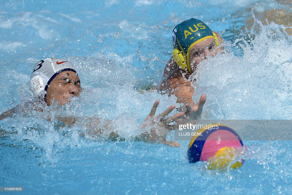 Australia's Jarrod Gilchrist (R) vies with China's Liang Zhongxing (L) during the preliminary round match of the men's water polo competition between China and Australia at the FINA World Championships at the Bernat Picornell swimming pool in Barcelona on July 24, 2013. AFP PHOTO/ LLUIS GENE