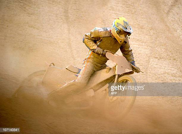 Australia's Jason Crump drives on the muddy track caused by heavy rain during heat five of the Swedish Speedway Grand Prix at Ullevi Stadium in...