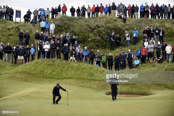 Australia's Jason Day and US golfer Zach Johnson on the 2nd green during their second rounds on day two of the Open Golf Championship at Royal...