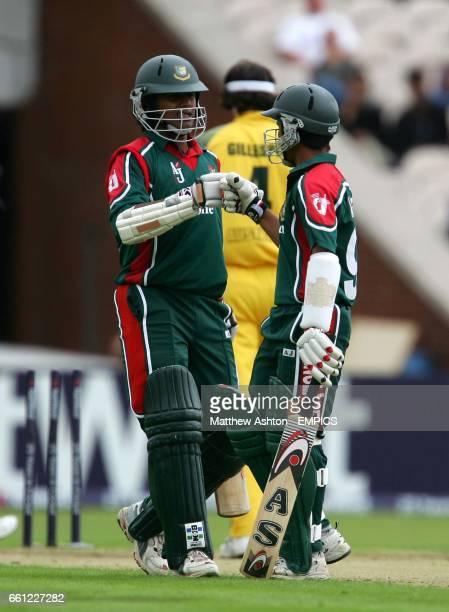 Australia's Jason Gillespie walks away as Bangladesh's batsmen Mohammed Ashraful and Shahriar Nafees congratulate each other after clocking up the...
