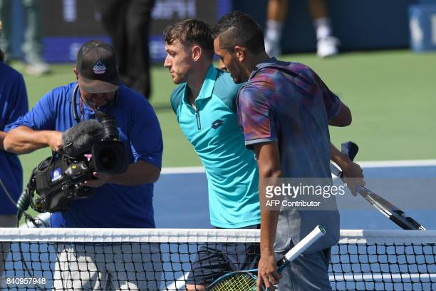 Australia's John Millman hugs Australia's Nick Kyrgios after defeating him in their Qualifying Men's Singles match at the 2017 US Open Tennis...