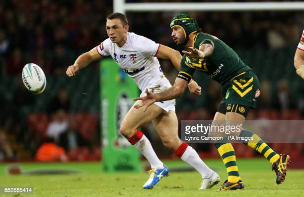 Australia's Johnathan Thurston and England's Kevin Sinfield in action
