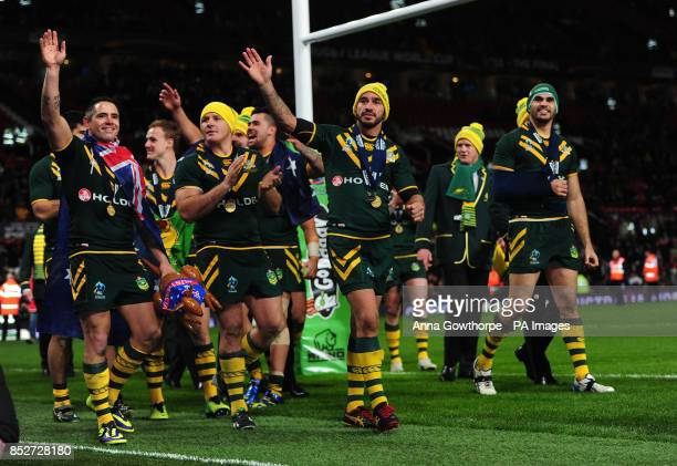 Australia's Johnathan Thurston celebrates with his teammates after their victory in the Rugby League World Cup Final at Old Trafford Manchester
