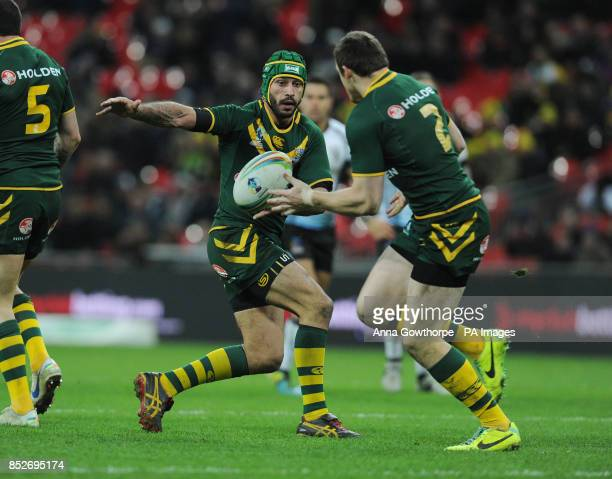 Australia's Johnathan Thurston passes the ball to Brett Morris during the World Cup Semi Final at Wembley Stadium London