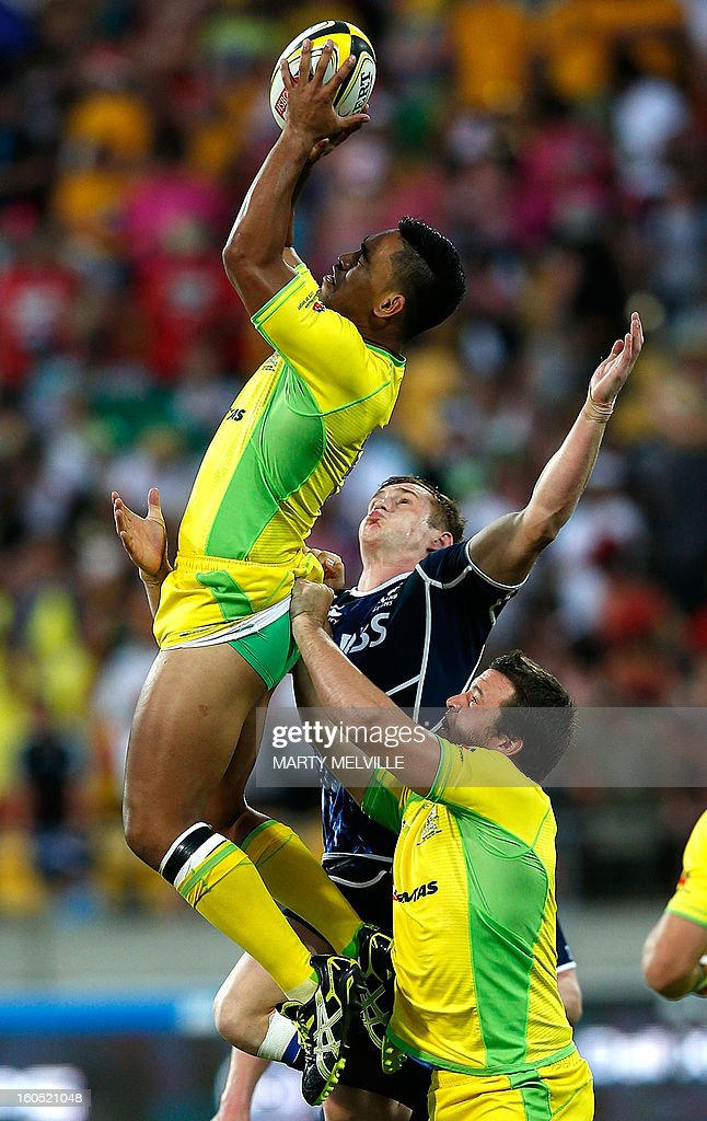 Australia's Jordan Tuapou (upper) jumps for the ball with Scotland's Russell Weir (C) and lifted by Australia's Ben Adams during their plate final at the Westpac Stadium on day two of the fourth leg of the IRB Rugby Sevens World Series in Wellington on February 2, 2013. AFP PHOTO / Marty MELVILLE