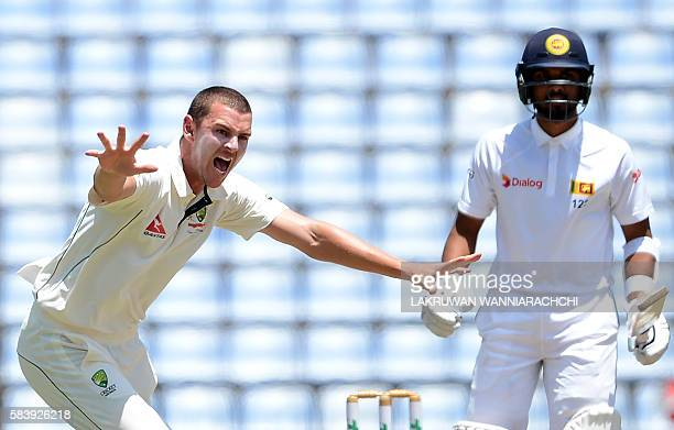 Australia's Josh Hazlewood makes an unsuccessful appeal for a Leg Before Wicket decision against Sri Lanka's Dinesh Chandimal during the third day of...