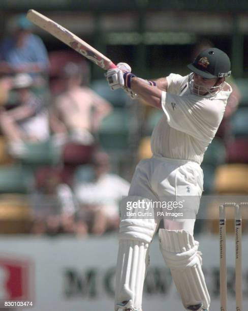 Australia's Justin Langer swipes at a ball from Angus Fraser today during the fourth day of the first Test at the Gabba in Brisbane Picture by BEN...