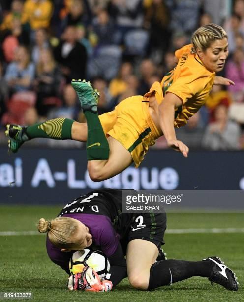 Australia's Katrina Gorry jumps over Brazil's goalkeeper Daniele Neuhaus Turnes in an effort to kick the ball during their women's friendly football...