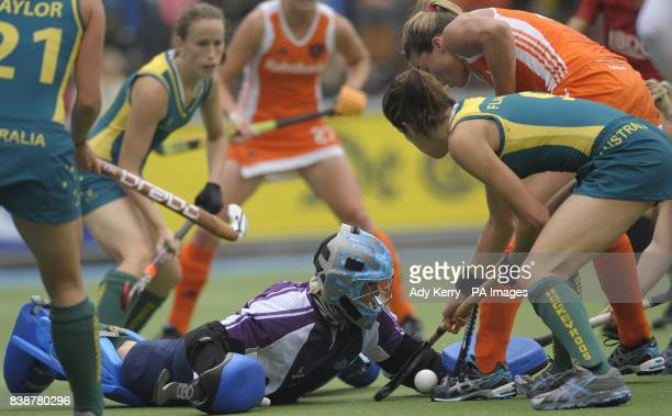 Australia's keeper Toni Cronk dives at the feet of Netherland's Kim Lammers during the Rabo FIH Women's Champions Trophy match at the Wagener Stadium...
