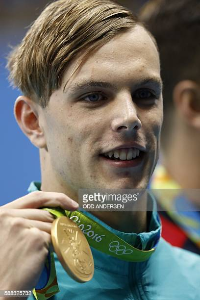 Australia's Kyle Chalmers poses with his gold medal on the podium of the Men's 100m Freestyle Final during the swimming event at the Rio 2016 Olympic...