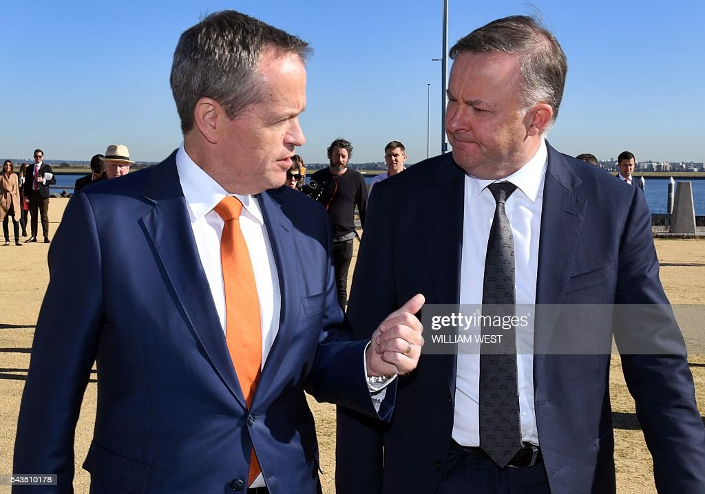 Australia's Labor Party leader Bill Shorten (R) chats with shadow minister for transport and infrastructure Anthony Albanese (L) before a press conference at Port Botany in Sydney on June 29, 2016, as Shorten campaigns to become prime minister at an election on July 2. Australians go to the polls faced with a choice between Prime Minister Malcolm Turnbull and Shorten. But there are also more than 50 minor players on the ballot, including a sex party, one for car enthusiasts and another with no policies. / AFP / WILLIAM