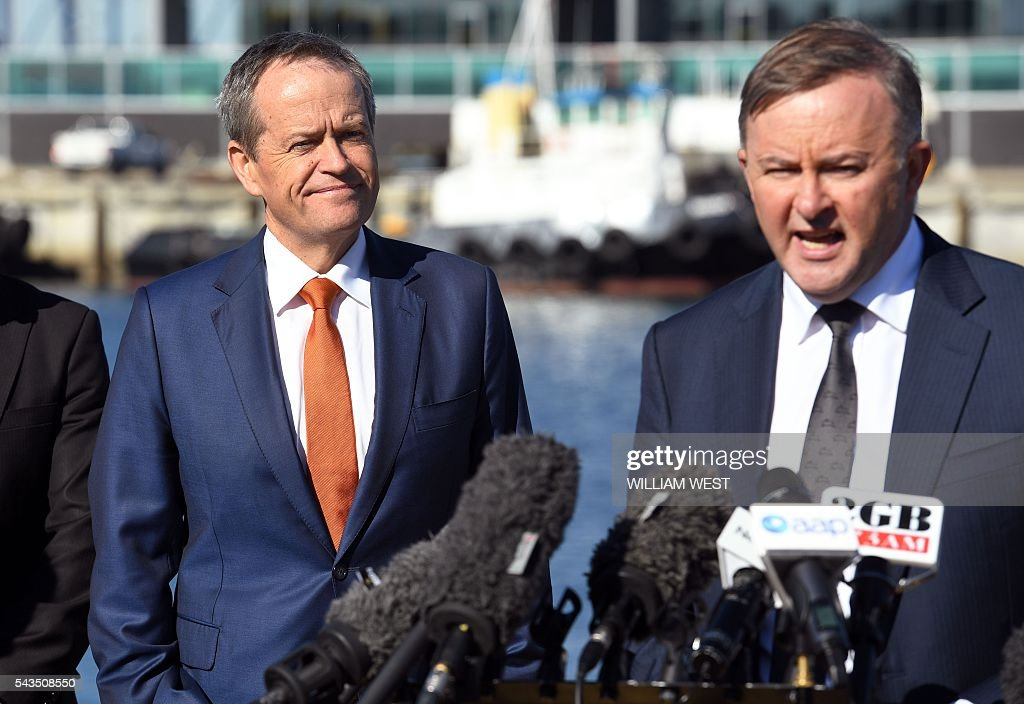 Australia's Labor Party leader Bill Shorten (L) listens to shadow minister for transport and infrastructure Anthony Albanese (R) during a press conference at Port Botany in Sydney on June 29, 2016, as he campaigns to become prime minister at an election on July 2. Australians go to the polls faced with a choice between Prime Minister Malcolm Turnbull and Shorten. But there are also more than 50 minor players on the ballot, including a sex party, one for car enthusiasts and another with no policies. / AFP / WILLIAM