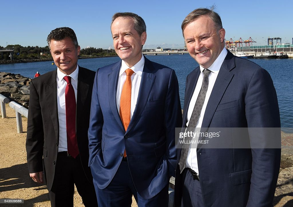 Australia's Labor Party leader Bill Shorten (C), shadow minister for transport and infrastructure Anthony Albanese (R) and local MP Matt Thistlethwaite (L) pose for a photo before a press conference at Port Botany in Sydney on June 29, 2016, as Shorten campaigns to become prime minister at an election on July 2. Australians go to the polls faced with a choice between Prime Minister Malcolm Turnbull and Shorten. But there are also more than 50 minor players on the ballot, including a sex party, one for car enthusiasts and another with no policies. Australians go to the polls faced with a choice between Prime Minister Malcolm Turnbull and Shorten. But there are also more than 50 minor players on the ballot, including a sex party, one for car enthusiasts and another with no policies. / AFP / WILLIAM