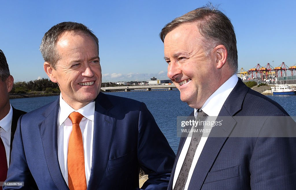 Australia's Labor Party leader Bill Shorten (L) smiles at shadow minister for transport and infrastructure, Anthony Albanese (R) before a press conference at Port Botany in Sydney on June 29, 2016, as Shorten campaigns to become prime minister at an election on July 2. Australians go to the polls faced with a choice between Prime Minister Malcolm Turnbull and Shorten. But there are also more than 50 minor players on the ballot, including a sex party, one for car enthusiasts and another with no policies. Australians go to the polls faced with a choice between Prime Minister Malcolm Turnbull and Shorten. But there are also more than 50 minor players on the ballot, including a sex party, one for car enthusiasts and another with no policies. / AFP / WILLIAM