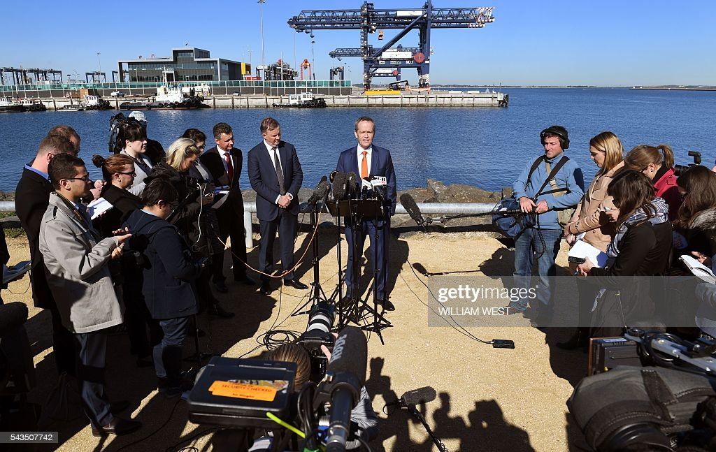 Australia's Labor Party leader Bill Shorten (C) speaks to the press at Port Botany in Sydney on June 29, 2016 as he campaigns to become prime minister at an election on July 2. Australians go to the polls faced with a choice between Prime Minister Malcolm Turnbull and Shorten. But there are also more than 50 minor players on the ballot, including a sex party, one for car enthusiasts and another with no policies. / AFP / WILLIAM