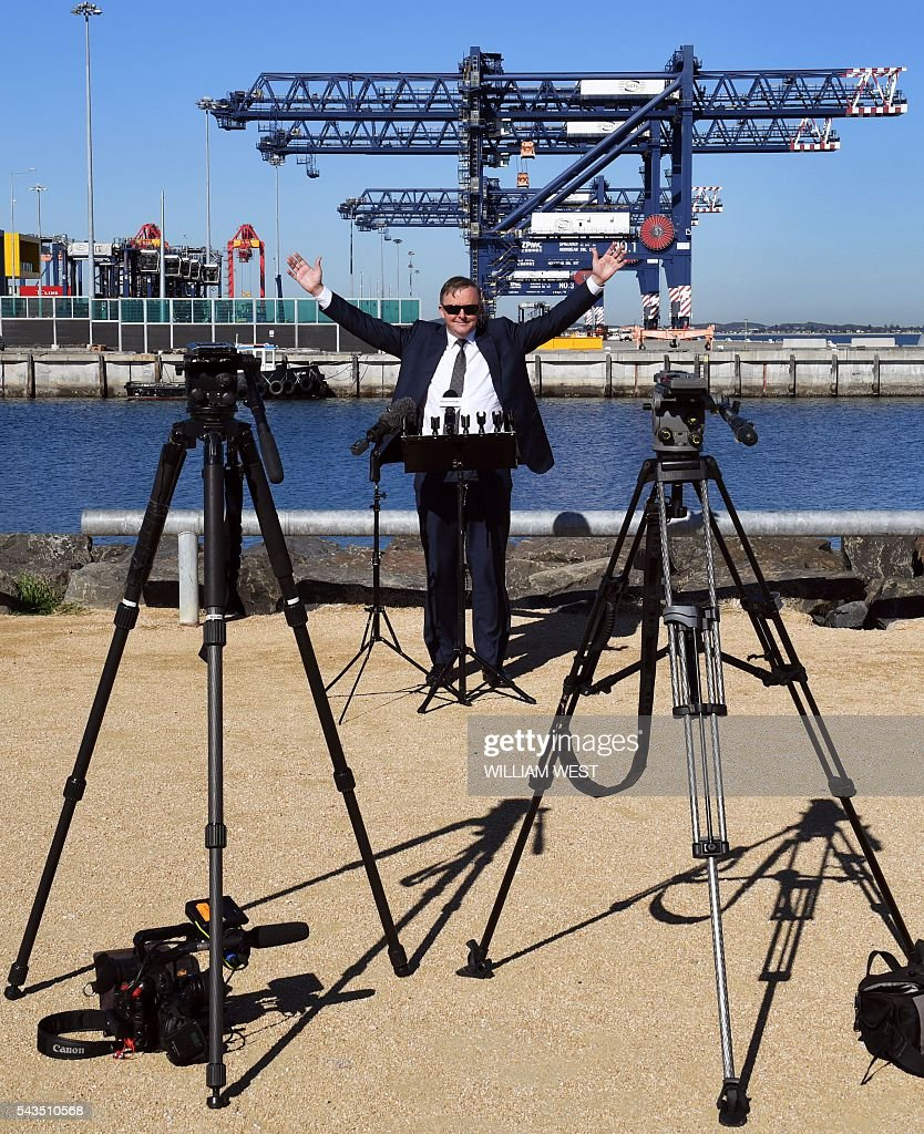 Australia's Labor Party shadow minister for transport and infrastructure Anthony Albanese stands behind a lecture as he waits for the media to arrive for a press conference at Port Botany in Sydney on June 29, 2016, ahead of the general election on July 2. Australians go to the polls faced with a choice between Prime Minister Malcolm Turnbull and Shorten. But there are also more than 50 minor players on the ballot, including a sex party, one for car enthusiasts and another with no policies. / AFP / WILLIAM