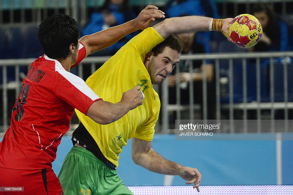 Australia's left back Ognjen Matic (R) vies with Egypt's right back Abou Elfetouh Ahmed during the 23rd Men's Handball World Championships preliminary round Group D match Egypt vs Australia at the Caja Magica in Madrid on January 19, 2013.