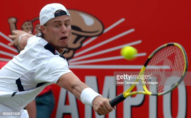 Australia's Lleyton Hewitt in action against France's JoWilfried Tsonga during the men's singles match in the Artois Championships at The Queen's...