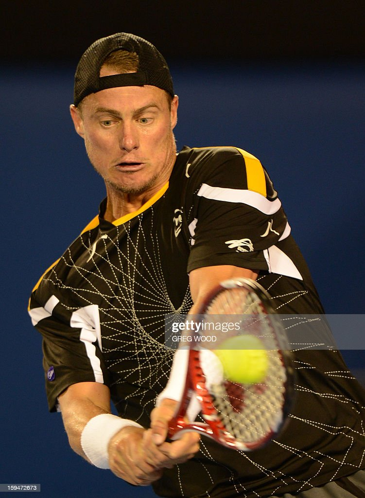 Australia's Lleyton Hewitt plays a return during his men's singles match against Serbia's Janko Tipsarevic on first day of the Australian Open tennis tournament in Melbourne on January 14, 2013.