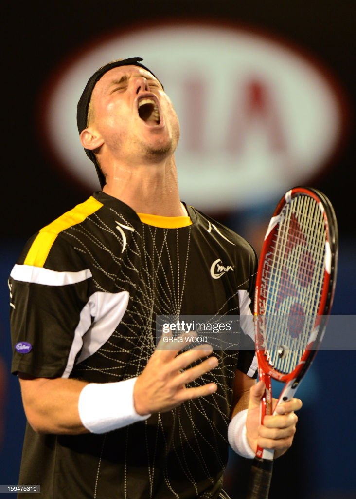 Australia's Lleyton Hewitt reacts during his men's singles match against Serbia's Janko Tipsarevic on first day of the Australian Open tennis tournament in Melbourne on January 14, 2013.