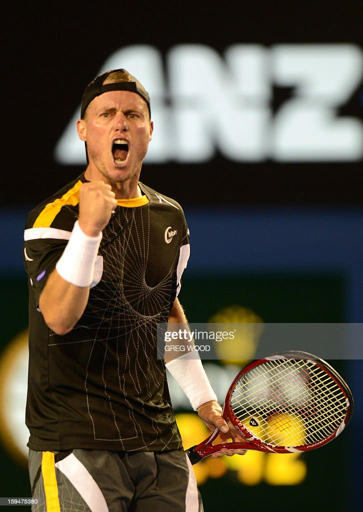 Australia's Lleyton Hewitt reacts during his men's singles match against Serbia's Janko Tipsarevic on first day of the Australian Open tennis tournament in Melbourne on January 14, 2013. AFP PHOTO/GREG WOOD IMAGE STRICTLY RESTRICTED TO EDITORIAL USE - STRICTLY NO COMMERCIAL USE