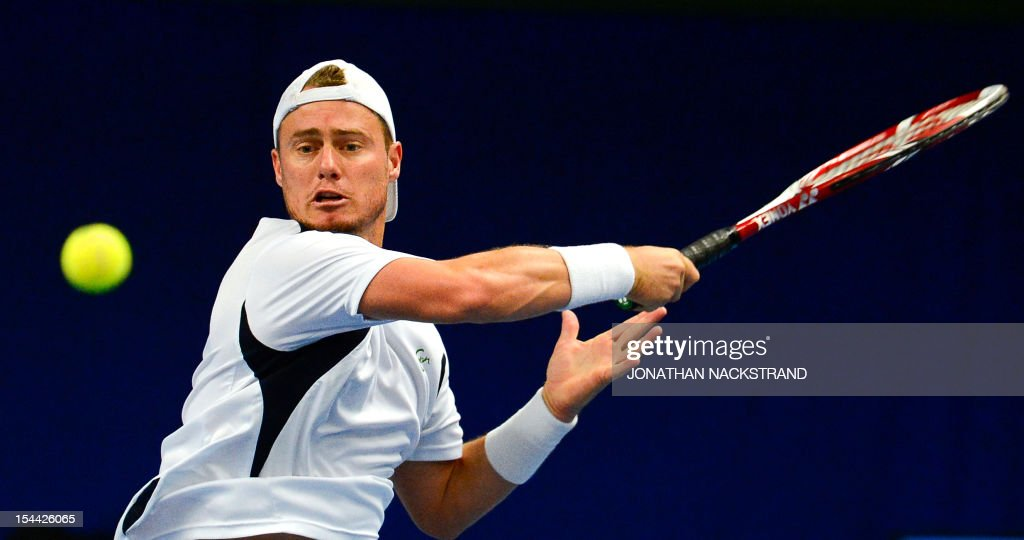 Australia's Lleyton Hewitt returns the ball to Spain's Nicolas Almagro during the quarter-finals at the ATP Stockholm Open tennis tournament on October 19, 2012 in Stockholm. Almagro 6-1, 6-4. AFP PHOTO/JONATHAN NACKSTRAND