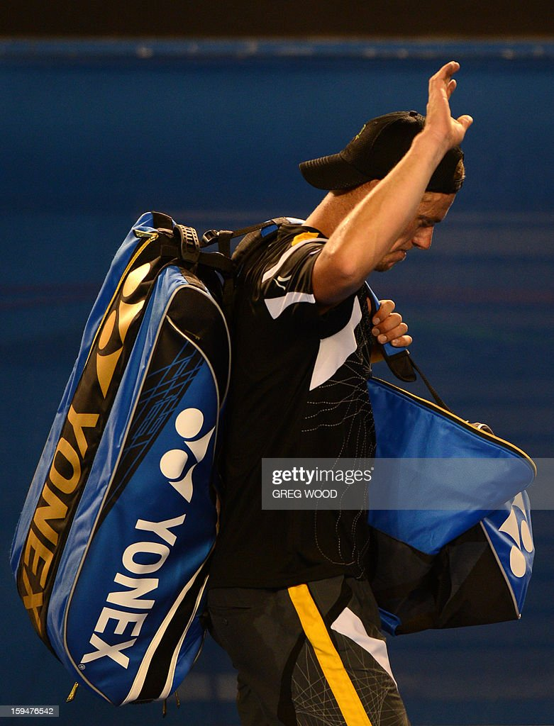 Australia's Lleyton Hewitt waves to the crowd after defeat in his men's singles match against Serbia's Janko Tipsarevic on first day of the Australian Open tennis tournament in Melbourne on January 14, 2013.