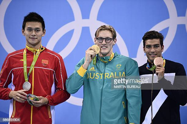 Australia's Mack Horton poses on the podium with silver medallist China's Sun Yang and bronze medallist Italy's Grabriele Detti after he won the...