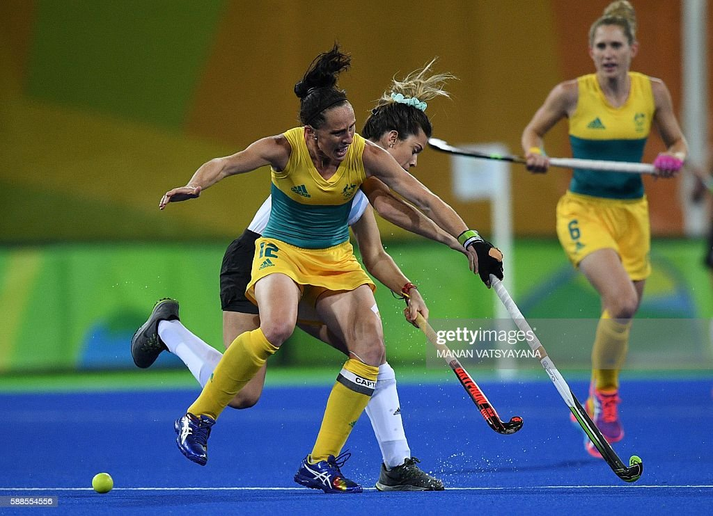 Australia's Madonna Blyth and Argentina's Agustina Albertarrio collide during the women's field hockey Australia vs Argentina match of the Rio 2016...