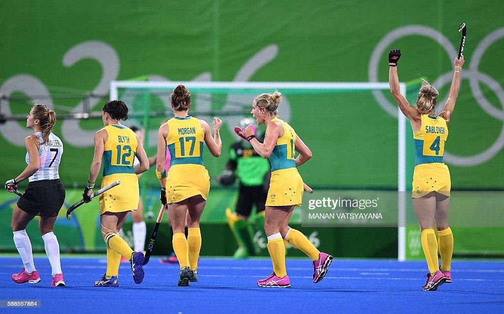 Australia's Madonna Blyth Georgina Morgan Gabi Nance and Casey Sablowski celebrate after their goalie stoped a penalty shot as Argentina's Martina...