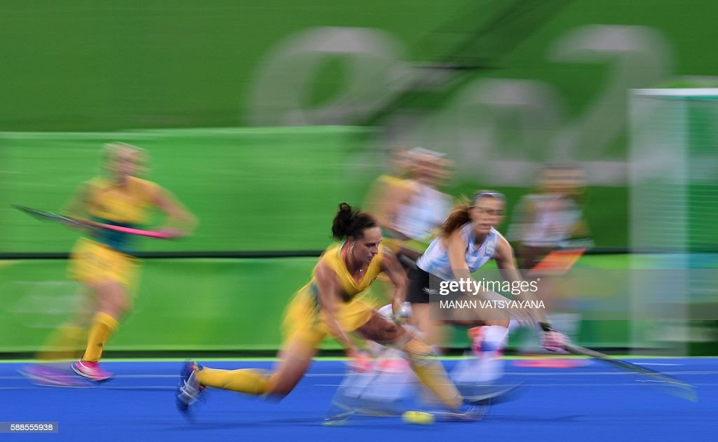 Australia's Madonna Blyth hits the ball during the women's field hockey Australia vs Argentina match of the Rio 2016 Olympics Games at the Olympic...