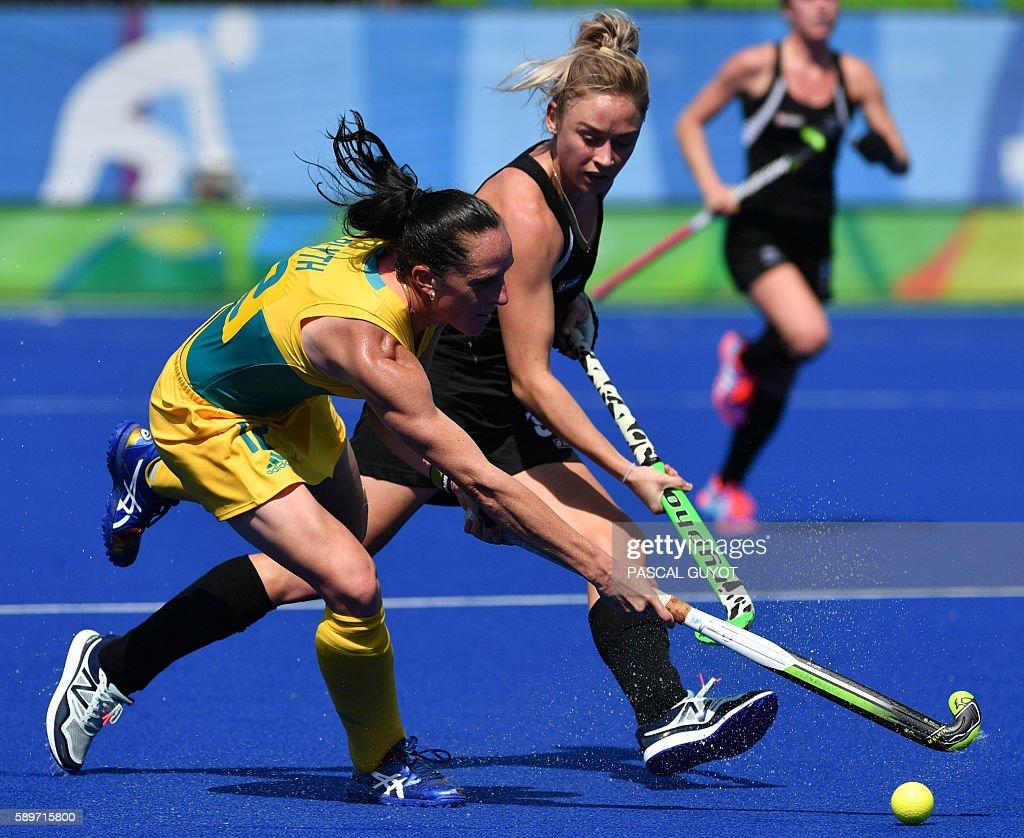 Australia's Madonna Blyth vies with New Zealand's Anita McLaren during the women's quarterfinal field hockey New Zealand vs Australia match of the...